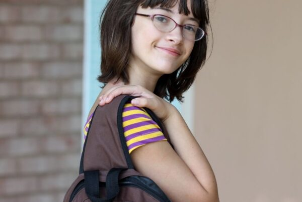 Teenager with backpack on the first day of school